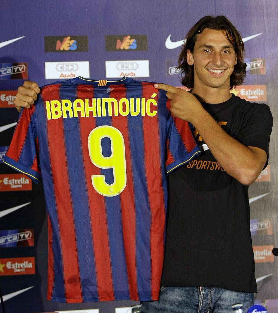 Barcelona's new siging Ibrahimovic of Sweden holds up his jersey in Barcelona