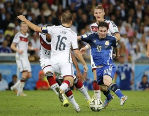 Argentina's Messi is challenged by Germany's Boateng and Lahm during their 2014 World Cup final at the Maracana stadium in Rio de Janeiro