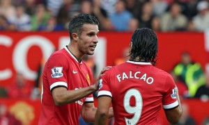 Robin van Persie talks to his Manchester United team-mate Radamel Falcao during the QPR match