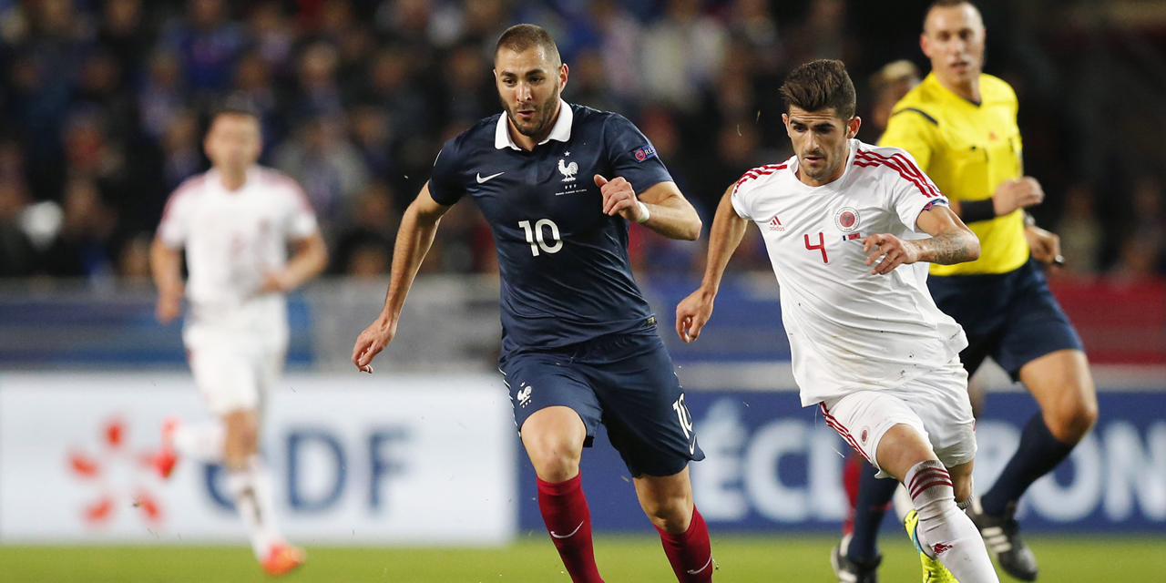 France's Benzema fights for the ball with Albania's Hysaj during their international friendly soccer match at the Route de Lorient stadium in Rennes