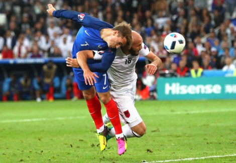 France's Antoine Griezmann (left) and Albania's Arlind Ajeti vie for the ball during the Euro 2016 Group A soccer match between France and Albania at the Velodrome stadium in Marseille, France, on Wednesday, June 15, 2016. Photo: AP