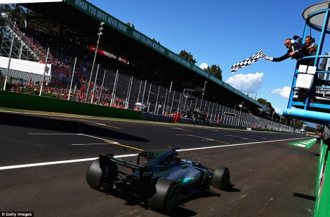 43DDA7C200000578-4848428-Hamilton_takes_the_chequered_flag_after_winning_the_Italian_Gran-a-13_1504445963660