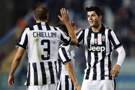 Juventus' Chiellini and Morata celebrate after defeating Empoli in their Italian Serie A soccer match in Empoli