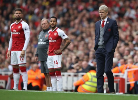 LONDON, ENGLAND - OCTOBER 01: Arsene Wenger manager of Arsenal looks on as Olivier Giroud and Theo Walcott of Arsenal prepare to come on during the Premier League match between Arsenal and Brighton and Hove Albion at Emirates Stadium on October 1, 2017 in London, England. (Photo by Julian Finney/Getty Images)