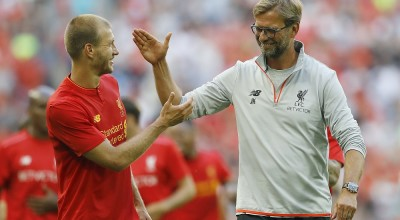 Liverpool's head coach Juergen Klopp, right and Liverpool's Ragnar Klavan gesture, after the team won the International Champions Cup soccer match between Liverpool and Barcelona at Wembley stadium in London, Saturday, Aug. 6, 2016 . (AP Photo/Frank Augstein)