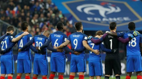 France's players stand together during a minute of silence to pay tribute to the victims, one year after a series of attacks at several sites in Saint-Denis and Paris, before their Group A 2018 World Cup Qualifying European Zone match at the Stade de France in Saint-Denis, near Paris, France, November 11, 2016. REUTERS/Benoit Tessier