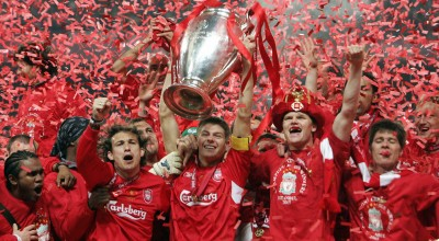Istanbul, Turkey:  Liverpool's captain Steven Gerrard holds the throphy surrounded by teammates at the end of the UEFA Champions league football final AC Milan vs Liverpool, 25 May 2005 at the Ataturk Stadium in Istanbul.  Liverpool won 3-2 on penalties.    AFP PHOTO FILIPPO MONTEFORTE  (Photo credit should read FILIPPO MONTEFORTE/AFP/Getty Images)