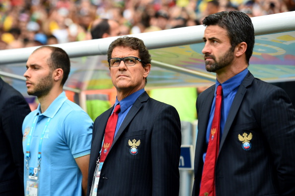 RIO DE JANEIRO, BRAZIL - JUNE 22: Head coach Fabio Capello (C) and assistant coach Christian Panucci (R) of Russia look on prior to the 2014 FIFA World Cup Brazil Group H match between Belgium and Russia at Maracana on June 22, 2014 in Rio de Janeiro, Brazil. (Photo by Shaun Botterill - FIFA/FIFA via Getty Images)