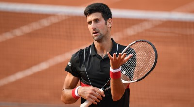 TOPSHOT - Serbia's Novak Djokovic reacts after a point in the fourth set against Italy's Marco Cecchinato during their men's singles quarter-final match on day ten of The Roland Garros 2018 French Open tennis tournament in Paris on June 5, 2018. (Photo by Christophe ARCHAMBAULT / AFP)        (Photo credit should read CHRISTOPHE ARCHAMBAULT/AFP/Getty Images)