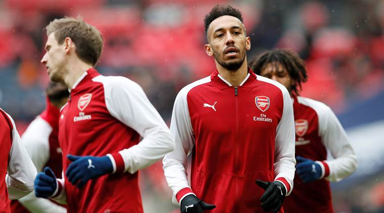 """Soccer Football - Premier League - Tottenham Hotspur vs Arsenal - Wembley Stadium, London, Britain - February 10, 2018 Arsenal's Pierre-Emerick Aubameyang warms up REUTERS/David Klein EDITORIAL USE ONLY. No use with unauthorized audio, video, data, fixture lists, club/league logos or """"live"""" services. Online in-match use limited to 75 images, no video emulation. No use in betting, games or single club/league/player publications. Please contact your account representative for further details."""