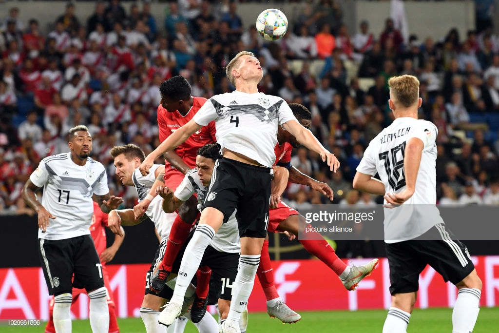 09 September 2018, Germany, Sinsheim: Soccer Friendly match: Germany vs Peru in the Wirsol Rhein-Neckar-Arena: Matthias Ginter (C) from Germany jumps to the ball. Photo: Uli Deck/dpa (Photo by Uli Deck/picture alliance via Getty Images)