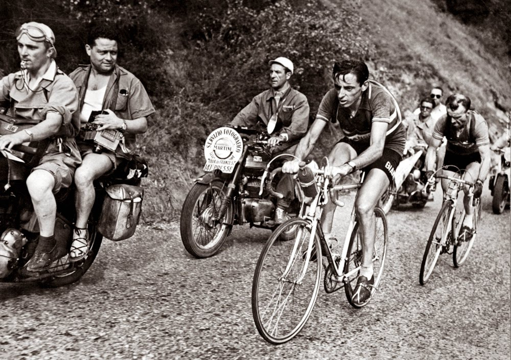 In this this photo provided by PhotoSport International shows Fausto Coppi catching and passing Jean Robic on Alpe d' Huez. (First time used by TdeF)