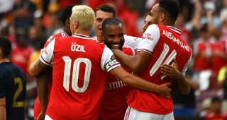 Arsenal's French striker Alexandre Lacazette (C) celebrates with teammates after scoring a goal during the International Champions Cup football match between Real Madrid and Arsenal at FedExField in Landover, Maryland, on July 23, 2019. (Photo by ANDREW CABALLERO-REYNOLDS / AFP)        (Photo credit should read ANDREW CABALLERO-REYNOLDS/AFP/Getty Images)