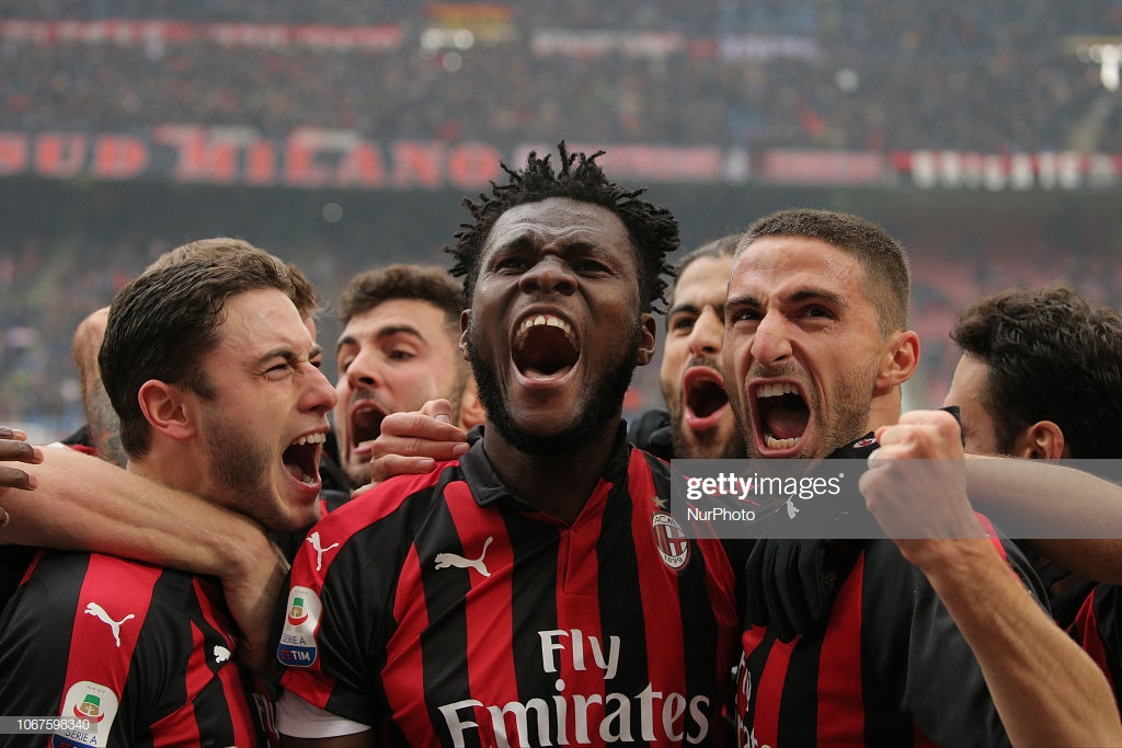 Frank Kessie #79 of AC Milan celebrates with Fabio Borini #11 of AC Milan after scoring the goal during the serie A match between AC Milan and Parma Calcio 1913 at Stadio Giuseppe Meazza on December 02, 2018 in Milan, Italy. (Photo by Giuseppe Cottini/NurPhoto via Getty Images)