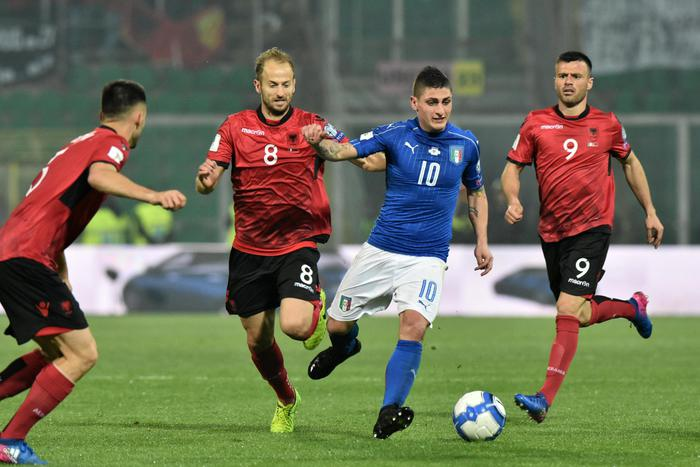 Italy's Marco Verratti (2R) contrastated by Albania's Ledian Memushaj (R) and Migjen Basha during the FIFA World Cup 2018 qualifying soccer match Italy vs Albania at Renzo Barbera stadium in Palermo, Sicily island, Italy, 24 March 2017. ANSA/MIKE PALAZZOTTO