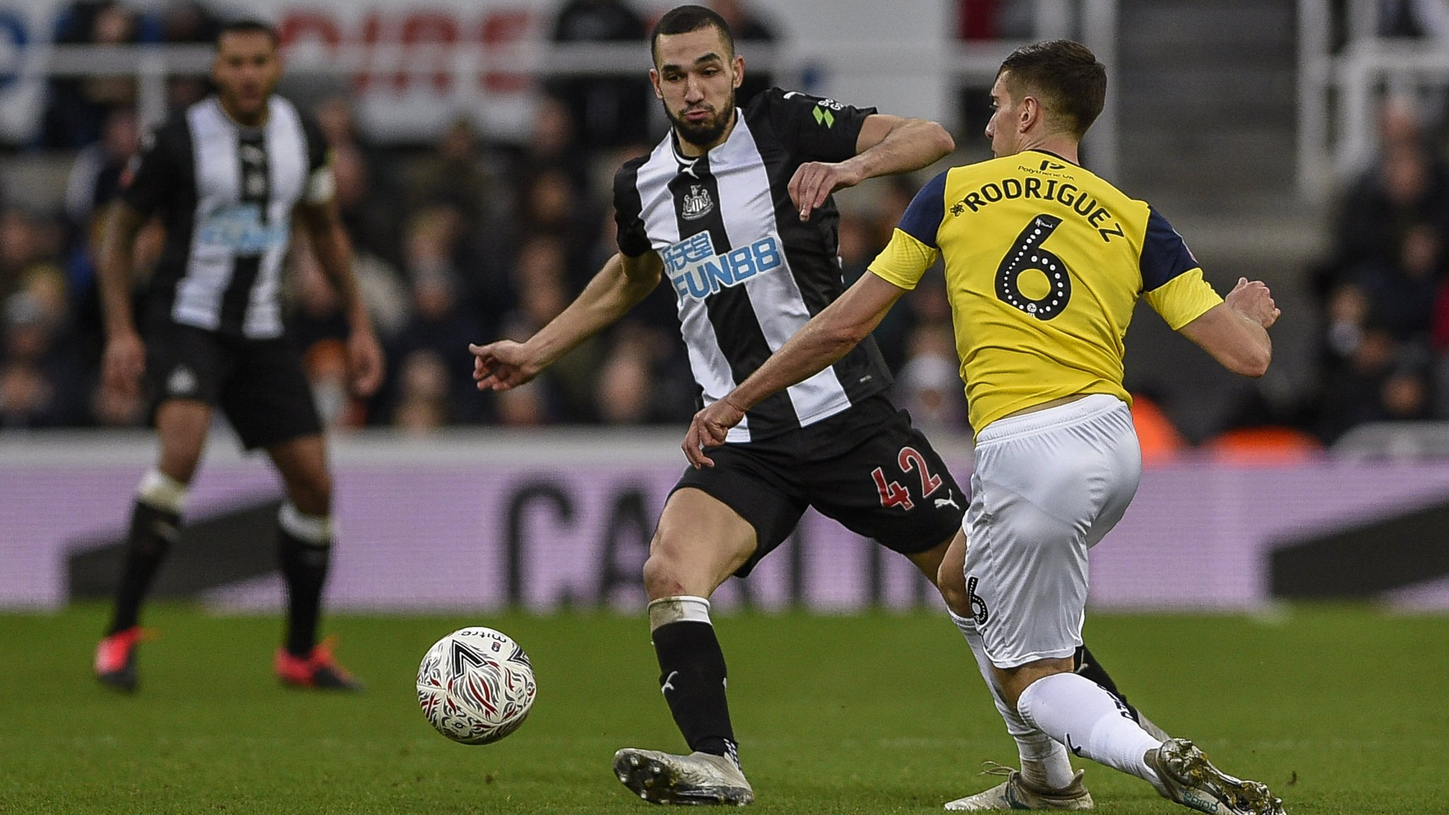 Alex Rodriguez of Oxford compete for the ball with Nabil Bentaleb of Newcastle during the FA Cup match between Newcastle United and Oxford United at St. James's Park, Newcastle on Saturday 25th January 2020. (Photo by Iam Burn/MI News/NurPhoto via Getty Images)