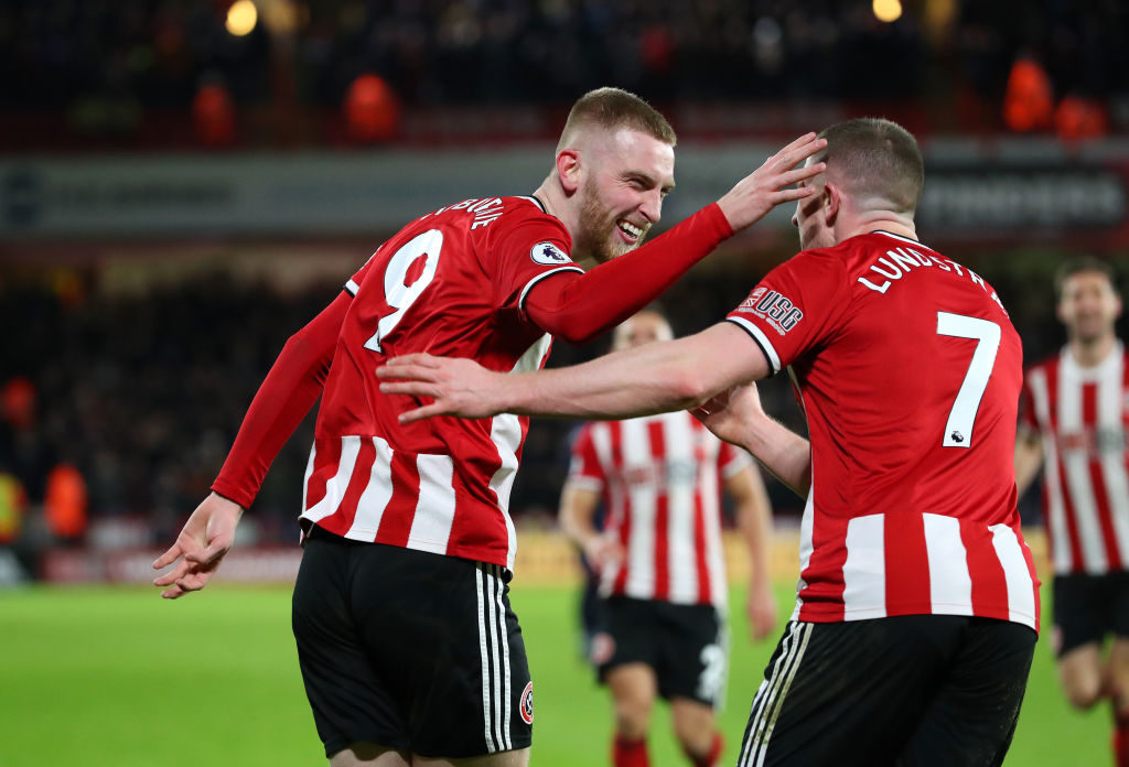 SHEFFIELD, ENGLAND - JANUARY 10: Oli McBurnie of Sheffield United celebrates with John Lundstram after scoring the opening goal during the Premier League match between Sheffield United and West Ham United at Bramall Lane on January 10, 2020 in Sheffield, United Kingdom. (Photo by Alex Livesey - Danehouse/Getty Images)