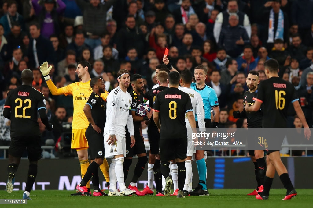 MADRID, SPAIN - FEBRUARY 26: Sergio Ramos of Real Madrid is shown a Red Card by Match referee Daniele Orsato of Italy during the UEFA Champions League round of 16 first leg match between Real Madrid and Manchester City at Bernabeu on February 26, 2020 in Madrid, Spain. (Photo by Robbie Jay Barratt - AMA/Getty Images)