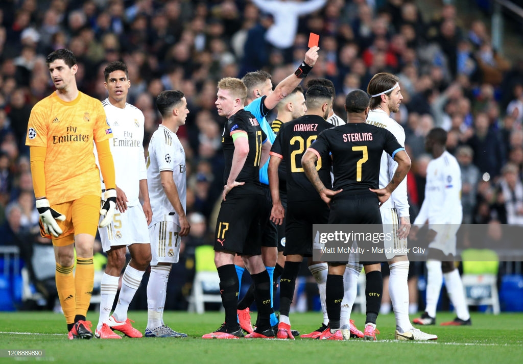 MADRID, SPAIN - FEBRUARY 26: Referee Daniele Orsato awards Sergio Ramos of Real Madrid a red card during the UEFA Champions League round of 16 first leg match between Real Madrid and Manchester City at Bernabeu on February 26, 2020 in Madrid, Spain. (Photo by Matt McNulty - Manchester City/Manchester City FC via Getty Images)