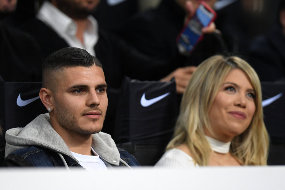 Soccer Football - Serie A - Inter Milan v Lazio - San Siro, Milan, Italy - March 31, 2019 Inter Milan's Mauro Icardi and his wife, Wanda Nara, sat in the stands before the match REUTERS/Daniele Mascolo