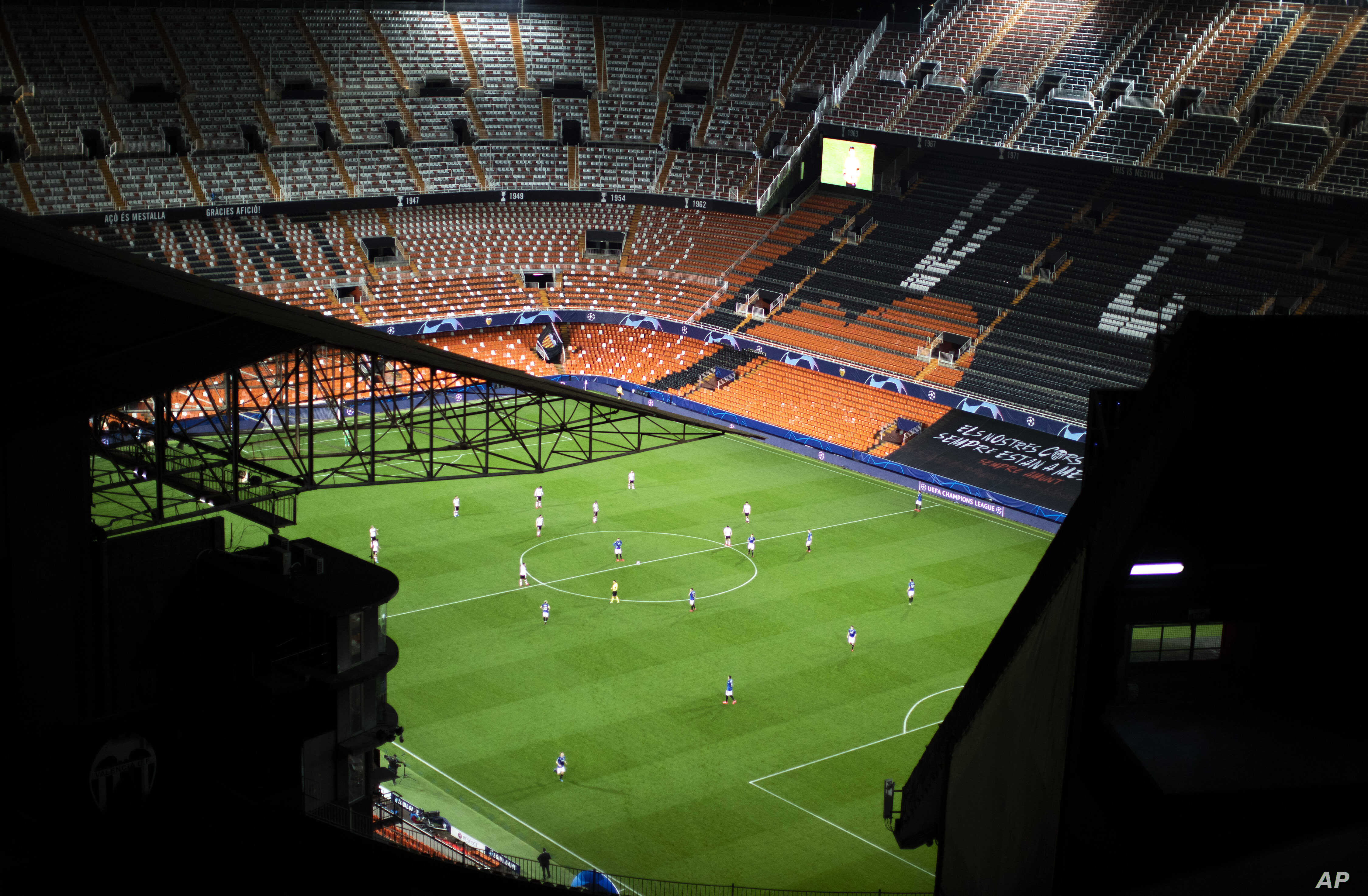 General view of the Mestalla stadium during the Champions League round of 16 second leg soccer match between Valencia and Atalanta in Valencia, Spain, Tuesday March 10, 2020. The match is being in an empty stadium because of the coronavirus outbreak. (AP Photo/Emilio Morenatti)