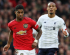 MANCHESTER, ENGLAND - OCTOBER 20: Marcus Rashford of Manchester United in action with Fabinho of Liverpool during the Premier League match between Manchester United and Liverpool FC at Old Trafford on October 20, 2019 in Manchester, United Kingdom. (Photo by John Peters/Manchester United via Getty Images)