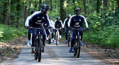 France's national football team midfielder N'Golo Kante (R) and team mates ride bicycles during the team's preparation for the upcoming FIFA World Cup 2018 in Russia on May 23, 2018 at the team's training site in Clairefontaine-en-Yvelines. (Photo by FRANCK FIFE / AFP)        (Photo credit should read FRANCK FIFE/AFP/Getty Images)