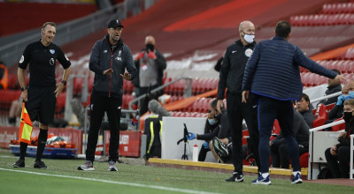 Liverpool's manager Jurgen Klopp, second left and Chelsea's head coach Frank Lampard, right, exchange words during the English Premier League soccer match between Liverpool and Chelsea at Anfield Stadium in Liverpool, England, Wednesday, July 22, 2020. (Phil Noble/Pool via AP)