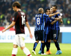 Inter Milan's Guarin, Icardi, Medel and Palacio celebrate at the end of their  Italian Serie A soccer match against AC Milan at the San Siro stadium in Milan