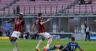 Zlatan Ibrahimovic of AC Milan is fouled by Aleksandar Kolarov of Internazionale in the penalty area for AC Milan to be