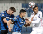 Real Madrid's Casemiro, right, heads the ball past Atalanta's Cristian Romero, center, and Atalanta's Berat Djimsiti during the Champions League, round of 16, first leg soccer match between Atlanta and Real Madrid, at the Gewiss Stadium in Bergamo, Wednesday, Feb. 24, 2021. (AP Photo/Luca Bruno)