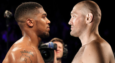 MANCHESTER, ENGLAND - DECEMBER 10:  Wladimir Klitschko of Ukraine looks at Anthony Joshua of England (L) following the announcement that the pair will fight at Wembley Stadium in April 2017, at Manchester Arena on December 10, 2016 in Manchester, England.  (Photo by Richard Heathcote/Getty Images)