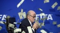 2AB2A77D00000578-0-FIFA_president_Sepp_Blatter_appeared_to_grasp_at_bank_notes_thro-a-4_1437498429188
