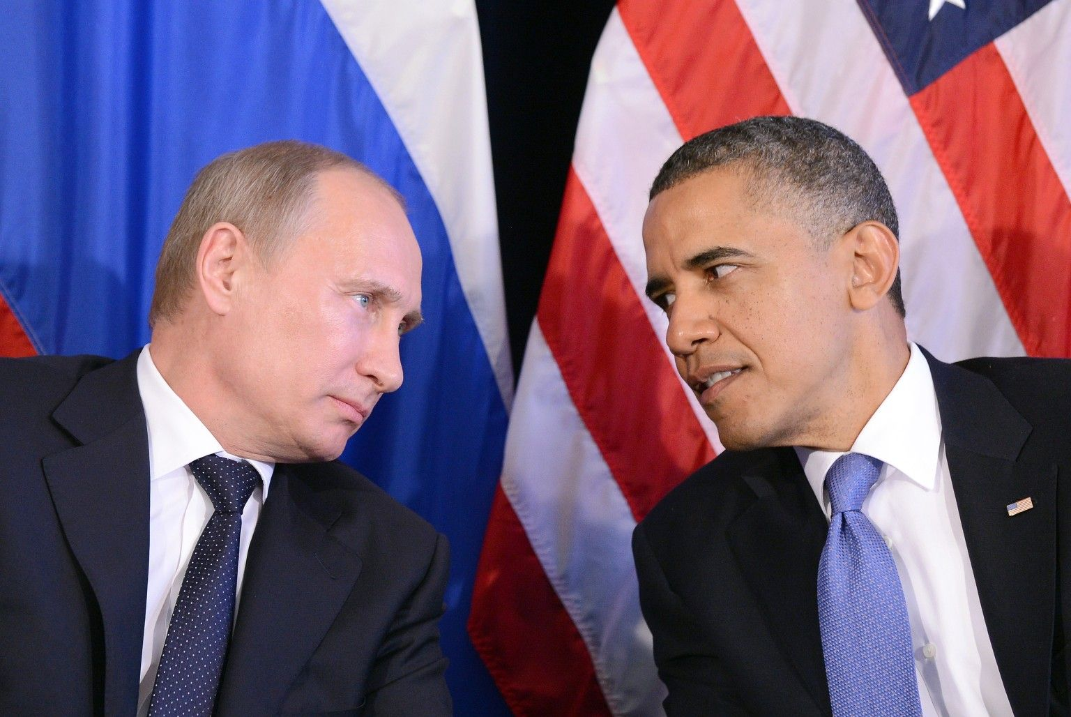 """US President Barack Obama (R) listens to Russian President Vladimir Putin after their bilateral meeting in Los Cabos, Mexico on June 18, 2012 on the sidelines of the G20 summit. Obama and President Vladimir Putin met Monday, for the first time since the Russian leader's return to the presidency, for talks overshadowed by a row over Syria. The closely watched meeting opened half-an-hour late on the sidelines of the G20 summit of developed and developing nations, as the US leader sought to preserve his """"reset"""" of ties with Moscow despite building disagreements. AFP PHOTO/Jewel Samad        (Photo credit should read JEWEL SAMAD/AFP/GettyImages)"""