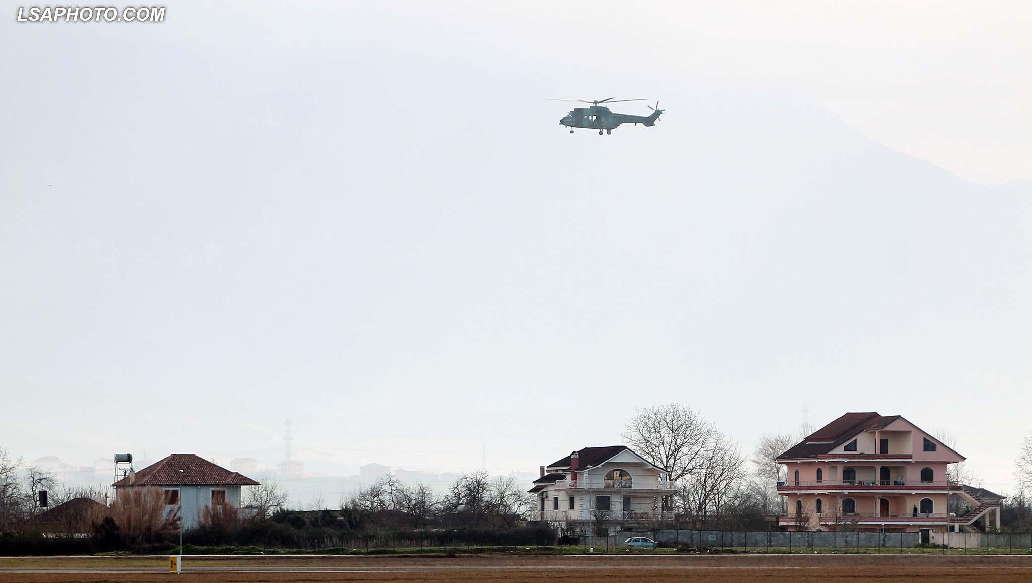 "MASAT E SIGURISE PER VIZITEN E KERRY - Nje helikopter i ushtrise, duke patrulluar mbi aeroportin ""Nene Tereza"", gjate vizites se Sekretarit Amerikan te Shtetit, John Kerry, i cili ndodhet per nje vizite zyrtare ne Tirane. /r/n/r/nSAFETY MEASURES FOR KERRY - An army helicopter, patrolling the airport ""Mother Teresa"", during the visit of US Secretary of State, John Kerry. US Secretary of State is in a few hours visit to Tirana, to meet with senior government leaders to discuss Albania's further Euro-Atlantic integration and strong bilateral cooperation with the United States."