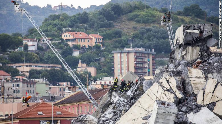 August 14, 2018 - Genoa, Liguria, Italy - The remains of the Morandi motorway bridge stands after it partially collapsed in Genoa, Italy, on Tuesday, Aug. 14, 2018. The famous bridge of highway A10 that connected the Liguria region with south Italy collapsed with many victims. (Credit Image: ?? Mauro Ujetto/NurPhoto via ZUMA Press)