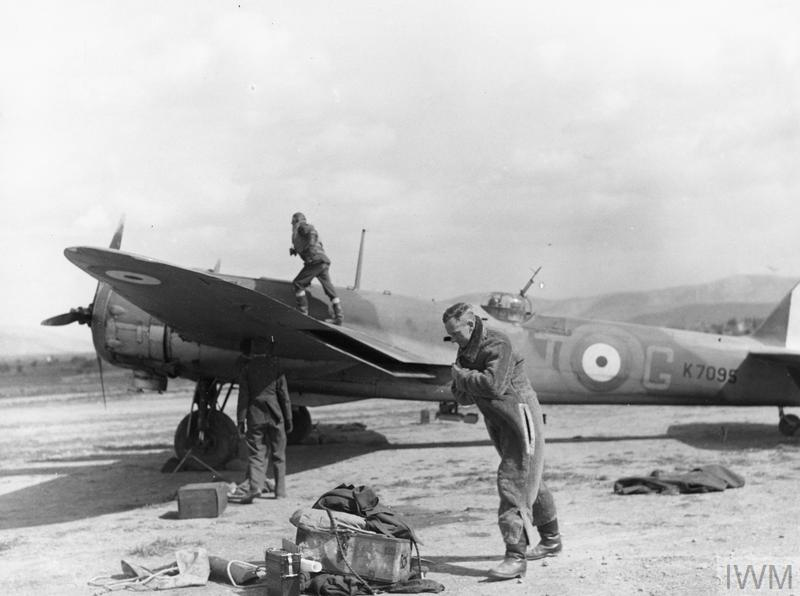 ROYAL AIR FORCE: OPERATIONS OVER ALBANIA AND IN GREECE, 1940-1941. (ME(RAF) 1100) Aircrew of 'A' Flight, No. 30 Squadron RAF, collect their equipment and board Bristol Blenheim Mark I, K7095 'VT-G', at Eleusis, Greece, for a raid on Italian targets in Albania. Copyright: © IWM. Original Source: http://www.iwm.org.uk/collections/item/object/205212052
