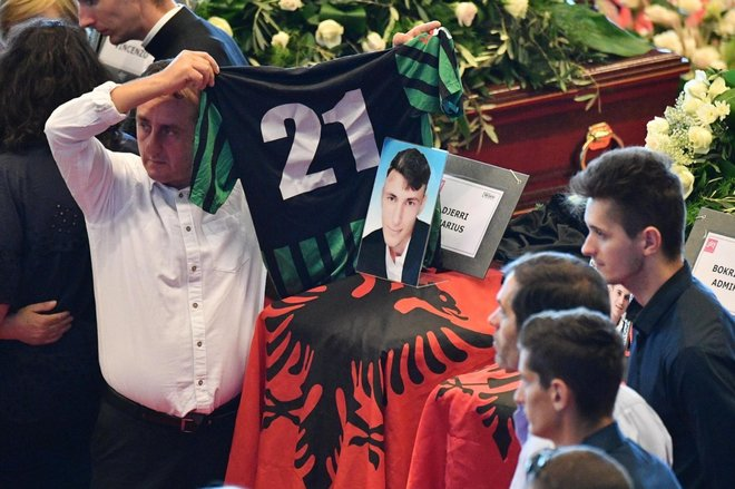 Players of the Campi Corniglianese soccer team mourn near the coffin of their teammate, 22 year-old Marius Djerri, one of the victims of the Genoa highway-bridge-collapse disaster, prior to the State funeral at the Fiera di Genova exhibition center, in Genoa, Italy, 18 August 2018. The Morandi bridge partially collapsed on 14 August, killing at least 41 people. ANSA/LUCA ZENNARO