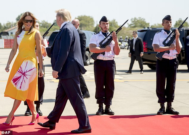 17659026-7392031-Two_French_soldiers_sent_Melania_Trump_left_side_eye_looks_while-m-3_1566710171685