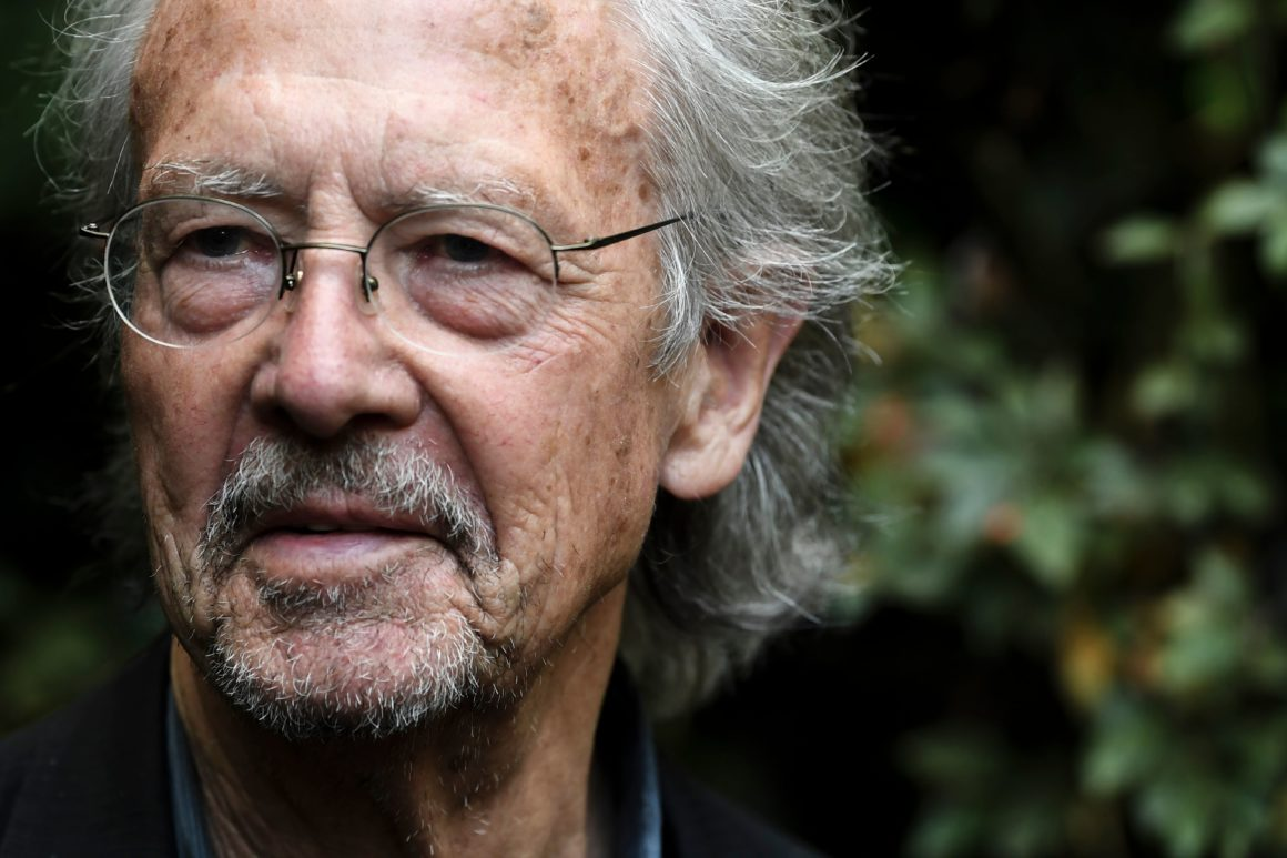 "Austrian writer Peter Handke poses in Chaville, in the Paris surburbs, on October 10, 2019 after he was awarded with the 2019 Nobel Literature Prize. - Austrian Peter Handke, one of the most original German-language writers alive, who once used his famously sharp tongue to call for the Nobel Prize in Literature to be abolished, was awarded with the 2019 Nobel Literature Prize on October 10. The prize brings its winner ""false canonisation"" along with ""one moment of attention (and) six pages in the newspaper,"" the novelist, playwright, poet and translator told Austrian media in 2014. (Photo by ALAIN JOCARD / AFP) (Photo by ALAIN JOCARD/AFP via Getty Images)"