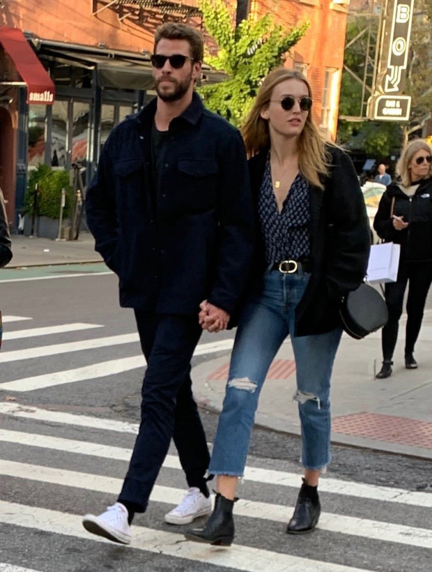 "BGUK_1750015 - *PREMIUM-EXCLUSIVE* ** RIGHTS: ONLY UNITED KINGDOM ** New York, NY - MUST CALL FOR PRICING BEFORE USAGE - The girl strolling the streets with Liam is Australian actress Maddison Brown ... a star on the CW show ""Dynasty."" Liam Hemsworth's showing the best way to get over an ex -- especially when she's moved on twice already -- is to move on yourself ... with another hot blonde. Liam was spotted in NYC's West Village neighborhood Thursday holding hands with a mystery woman ... both of them rocking jackets and sunglasses. The two enjoyed a meal and some drinks together at Sant Ambroeus ... before going on a romantic stroll. Can't say Liam's date's a total Miley Cyrus look-alike ... but the similarities are there. Hemsworth's stepping out with a new chick ... more subtle than Miley flaunting her fling with Australian singer Cody Simpson. As we've reported ... Liam showed off his guns earlier this week while filming a new TV series in Canada, on the heels of Miley making out with her new man and showing off his bod on social media. Simpson also played the role of Cyrus' hunky home nurse after she got out of the hospital for tonsillitis ... helping her recover from surgery. As you know ... Liam and Miley split in August and he filed for divorce shortly afterward. The breakup got pretty nasty, but it seems like they're both back on their feet. So ... let their back-and-forth games continue. **MANDATORY CREDIT: TMZ/BACKGRID** Pictured: Liam Hemsworth, Maddison Brown BACKGRID UK 11 OCTOBER 2019 BYLINE MUST READ: TMZ / BACKGRID UK: +44 208 344 2007 / uksales@backgrid.com USA: +1 310 798 9111 / usasales@backgrid.com *UK Clients - Pictures Containing Children Please Pixelate Face Prior To Publication*"