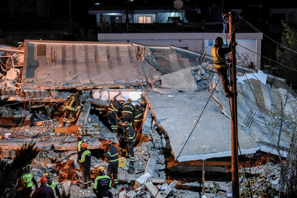 Italian search and rescue team search for six members of Lala family stuck under the rubble of a collapsed building in the town of Durres on November 27, 2019 in Durres, after an earthquake hit Albania. - Albania was in national mourning on November 27 as emergency workers continued to pull bodies from the ruins of buildings gutted by a violent earthquake, with nearly 30 dead found so far and more than 40 rescued alive. Tirana declared a state of emergency in the areas hardest-hit by the November 26 pre-dawn earthquake: the coastal city of Durres and the town of Thumane, where victims were trapped by toppled buildings. (Photo by Armend NIMANI / AFP)