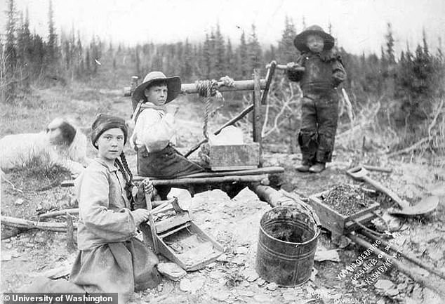 21204548-7702261-The_image_shows_three_children_extracting_water_from_a_well_in_t-a-59_1574176944237