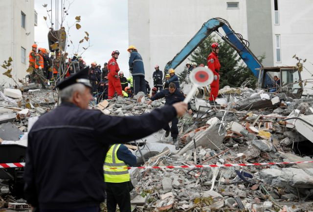 Emergency personnel search for survivors in a collapsed building in Durres, after an earthquake shook Albania, November 28, 2019. REUTERS/Florion Goga