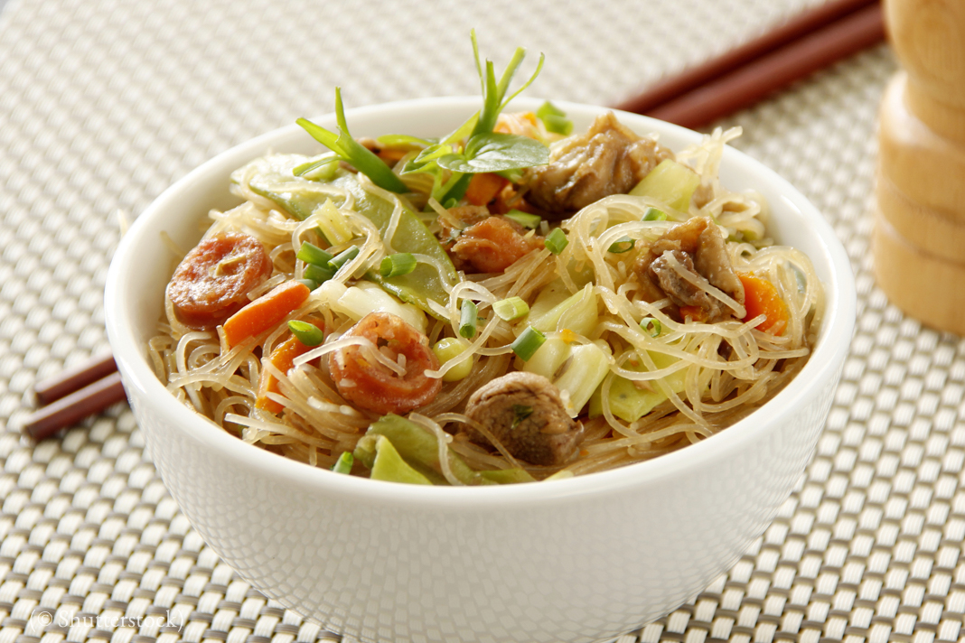 Fried Pancit bihon noodles serve on bowl with chopstick (© Shutterstock)