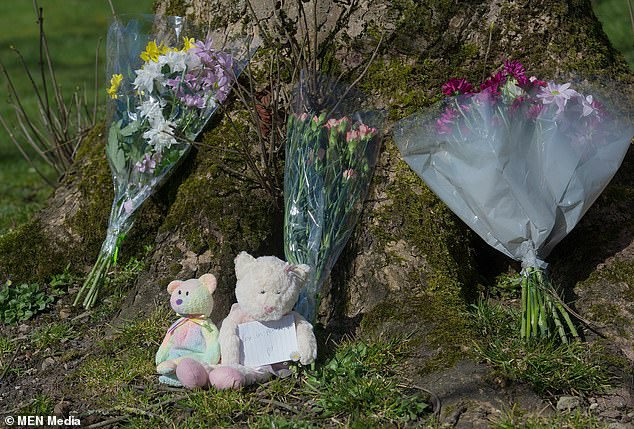 26717398-8179463-Floral_and_cuddly_toy_tributes_to_the_seven_year_old_girl_Follow-a-1_1585820223688