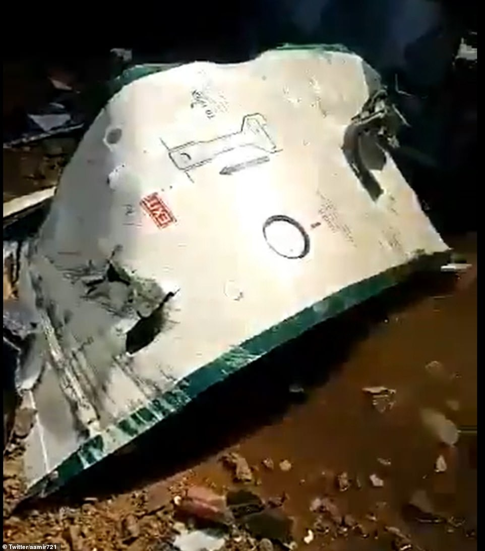28700460-8347577-A_wrecked_door_from_the_plane_is_seen_in_the_residential_area_of-m-6_1590147913482