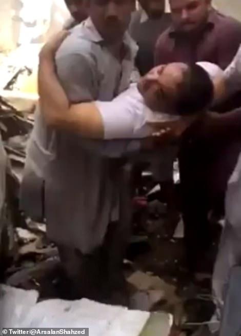 28706662-8347577-Bank_of_Punjab_president_Zafar_Masood_was_dragged_from_the_smoki-m-23_1590158370253