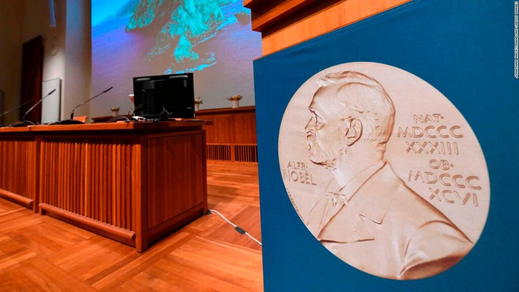 The portrait of Alfred Nobel is seen at the speaker's desk prior to the announcement of the winners of the 2020 Nobel Prize in Physiology or Medicine at the Karolinska Institute in Stockholm, Sweden, on October 5, 2020. (Photo by Jonathan NACKSTRAND / AFP) (Photo by JONATHAN NACKSTRAND/AFP via Getty Images)