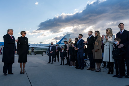 US President Donald Trump and First Lady Melania Trump meet Ivanka Trump (2nd R), husband Jared Kushner (R), their children, Eric (C-R) and Donald Jr. (C-R) and Trump family members stand on the tarmac at Joint Base Andrews in Maryland as they attend US President Donald Trump's departure on January 20, 2021. - President Trump travels to his Mar-a-Lago golf club residence in Palm Beach, Florida, and will not attend the inauguration for President-elect Joe Biden. (Photo by ALEX EDELMAN / AFP) (Photo by ALEX EDELMAN/AFP via Getty Images)
